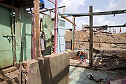 Remains of Rubina Ali's house in the slum where she still lives with her family next to the train station of Bandra (East), Mumbai, India, are photographed after her home was recently demolished with no notice as it lay on land owned by the Maharashtra train authorities. She is now permanently living with her uncle's family in a home a stone-throw away in the same slum. Rubina Ali, 9, is the child actor playing the role of 'young Latika', the friend/lover of Jamal, protagonist of Slumdog Millionaire, the famous movie winner of 8 Oscar Academy Awards in December 2008. Various promises were made to lift the two young actors (Azharuddin Ismail and Rubina Ali) from poverty and slum-life but as of the end of May 2009 anything is yet to happen. Azharuddin's home too was demolished in the past two weeks, as it happens every year in his case, because the concrete walls were preventing local authorities to clear a drain passing right behind it. As usual, his father is looking into restoring the walls as soon as the work on the drain has been completed.