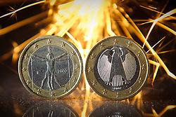 THEMENBILD - Euromuenze. Eine italienische 1 Euro Muenze (links) und eine deutsche 1 Euro Muenze (rechts) stehen im Funkenschlag einer Wunderkerze. Aufgenommen am 16/11/2011 in Knittelfeld. EXPA Pictures © 2011, PhotoCredit: EXPA/ S. Zangrando