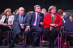 © Licensed to London News Pictures . 24/09/2014 . Manchester , UK . Ed Balls (2nd from right) in the audience listening to the Shadow Home Secretary Yvette Cooper deliver her speech to the conference . The Labour Party Conference 2014 . Photo credit : Joel Goodman/LNP