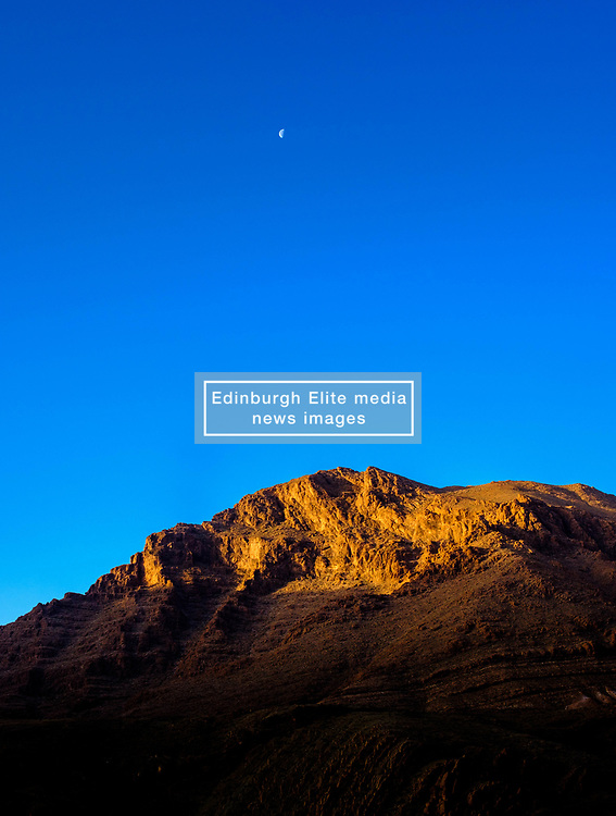 First rays of sunlight catch the top of the mountains in the Todra Gorge, Morocco<br /> <br /> (c) Andrew Wilson   Edinburgh Elite media