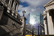 On the day that Chancellor of the Exchequer Rishi Sunak unveiled a £30bn package to boost the economy and get the country through the coronavirus outbreak, the financial insitutions are sunlit: the Bank of England (left) and Royal Exchange (right) in the capital's financial district, as the bank's governor Mark Carney cut the interest rate from 0.75% to 0.25%, on 11th March 2020, in the City of London, England.