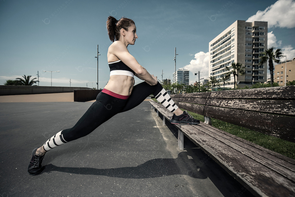 Woman doing stretching exercises in the city