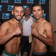 Christopher Diaz (L) and Raul Hirales are seen during weigh ins for the Top Rank boxing event at Osceola Heritage Park in Kissimmee, Florida on September 21, 2016.