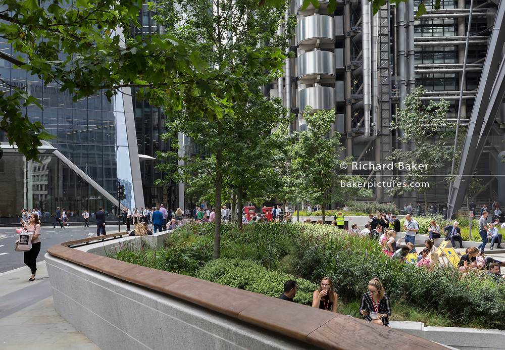 Lunchtime crowds enjoy summer sunshine in Leadenhall in the City of London, the capital's financial district (aka the Square Mile), on 10th July 2019, in London England.