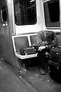 12/22/06 Chicago, IL Man sleeping on a Downtown Chicago subway train..(Chris Machian/ Prairie Pixel Group)..