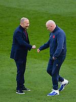 Rugby Union - 2020 Autumn Nations Cup - Final - England vs France - Twickenham<br /> <br /> England's Head Coach Eddie Jones with Frances's defence coach Shaun Edwards.<br /> <br /> COLORSPORT/ASHLEY WESTERN