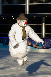 Natural History Museum, London, November 30th 2016. On the coldest week of the year The Snowman from from The Peacock Theatre's production takes to the ice at the Natural History Museum Ice Rink in London.