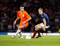 Football<br /> 09/09/2009 <br /> SCOTLAND V NETHERLANDS: <br /> ROBIN VAN PERSIE SLIPS PAST DARREN FLETCHER (SCO)  DURING THE 2010 WORLD CUP QUALIFIER AT HAMPDEN PARK, GLASGOW.<br /> CREDIT: COLORSPORT