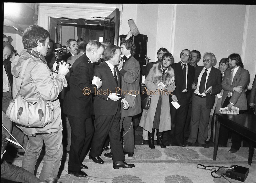 Charles Haughey,New Fianna Fáil Leader  (N5)..1979..07.12.1979..12.07.1979..7th December 1979..Today saw the election of Mr Charles Haughey as leader of Fianna Fáil. Mr Haughey takes over the role after the resignation of Jack Lynch.In a surprise result Mr Haughey beat the party favourite Mr George Colley TD..Image shows Mr Haughey being escorted through the media throng by a dáil usher after his election as Fianna Fáil leader.