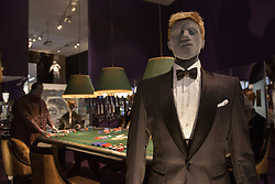 © licensed to London News Pictures. London, UK 05/07/2012. James Bond costume seen in Casino Royale being shown with many Bond items which have been used in the movies in the last 50 years at Designing 007 exhibition at Barbican Centre. Photo credit: Tolga Akmen/LNP