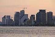 Israel, Tel Aviv Beachfront and skyline at dusk