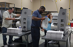 Election workers place ballots into electronic counting machines on Sunday, November 11, 2018, at the Broward Supervisor of Elections office in Lauderhill, FL, USA. The Florida recount began Sunday morning in Broward County. Photo by Joe Cavaretta/Sun Sentinel/TNS/ABACAPRESS.COM