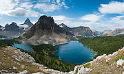The shoulder of Nub Peak gives an impressive view of Mount Assiniboine (3618 meters / 11,870 feet) and Wedgewood Peak rising above Lake Magog, Sunburst Lake, and Cerulean Lake (left to right) in Mount Assiniboine Provincial Park, British Columbia, Canada. This is part of the Canadian Rocky Mountain Parks World Heritage Site declared by UNESCO in 1984. Panorama stitched from 6 images.