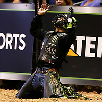 LAS VEGAS, NV - JUNE 11: Jose Vitor Leme celebrates following his ride of bull Cha Ching during the PBR Las Vegas Invitational, on June 11, 2021, at the MGM Grand Garden Arena, in Las Vegas, Nevada. (Photo by Chris Elise)