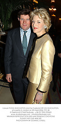 Lawyer FIONA SHACKLETON and her husband MR IAN SHACKLETON, at a party in London on 5th April 2004.PTC 48