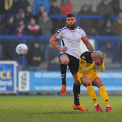 TELFORD COPYRIGHT MIKE SHERIDAN 19/1/2019 - Shane Sutton of AFC Telford battles with Ashley Chambers during the Vanarama Conference North fixture between AFC Telford United and Kidderminster Harriers