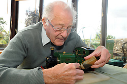 A retired man cleans his model train,  MODEL RELEASED