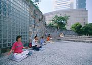 People meditating in City Hall Plaza adjacent to Taipei 101.