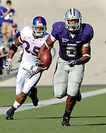 MANHATTAN, KS - NOVEMBER 07:  Running back Daniel Thomas #8 of the Kansas State Wildcats rushes past strong safety Darrell Stuckey #25 of the Kansas Jayhawks for a first down in the first half on November 7, 2009 at Bill Snyder Family Stadium in Manhattan, Kansas.  (Photo by Peter G. Aiken/Getty Images)