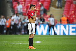 Manchester United's Alexis Sanchez stands dejected after the game
