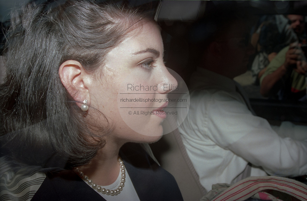 White House intern Monica Lewinsky leaves her lawyers offices after striking a deal for immunity with independent prosecutor Kenneth Starr July 29, 1998 in Washington, DC. Starr has agreed to grant immunity to Lewinsky in return for her cooperation in the investigation.