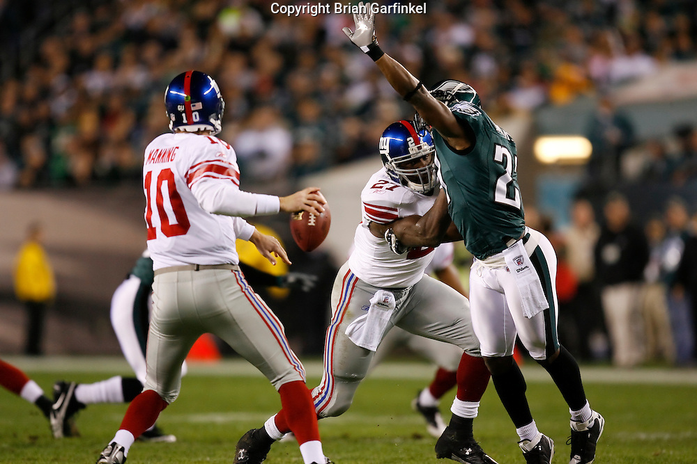 9 Oct 2008: Philadelphia Eagles safety Quintin Mikell #27 jumps towards New York Giants quarterback Eli Manning #10 in an attempt to block a pass during the game against the New York Giants on October 9th, 2008. The Giants won 36-31 at Lincoln Financial Field in Philadelphia, Pennsylvania.