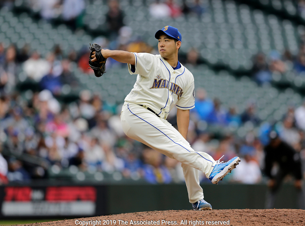 Seattle Mariners starting pitcher Yusei Kikuchi winds up a pitch to the Baltimore Orioles during a baseball game, Sunday, June 23, 2019, in Seattle. (AP Photo/John Froschauer)