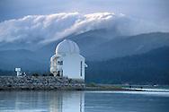 Morning storm clouds over mountains above solar observatory, Big Bear Lake, San Bernardino County, California