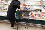 elderly woman grocery shopping in a supermarket Japan
