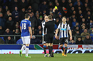 Jonjo Shelvey of Newcastle United is booked by referee Craig Pawson. Barclays Premier League match, Everton v Newcastle United at Goodison Park in Liverpool on Wednesday 3rd February 2016.<br /> pic by Chris Stading, Andrew Orchard sports photography.