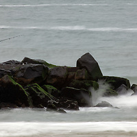 A fisherman heading out on the Garfield Avenue Jetty in Avon by the Sea New Jersey