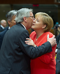 Angela Merkel, Germany's chancellor, right, is greeted by Jean-Claude Juncker, Luxembourg's prime minister, during the European Summit meeting at EU Council headquarters in Brussels, Belgium, on Thursday, June 17, 2010. (Photo © Jock Fistick)