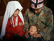 Lucky family, no children died so far. Wife Adil Bail, Ergish Boi and son Urkuya..Campment of Ortobil (Sufi), all the way at the end of the Little Pamir, near the Tajik/China border. .Winter expedition through the Wakhan Corridor and into the Afghan Pamir mountains, to document the life of the Afghan Kyrgyz tribe. January/February 2008. Afghanistan