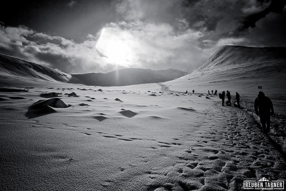 Climbers walk in to the Northern Corriers on Cairngorm mountain, Scotland.