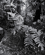 William Rickets Sanctuary - Black and white photo art print of Sculpture of an Aboriginal girl in the deep woodland of the Dandenon Mountain near Melbourne Australia. Taken 1993 by Paul Williams,
