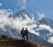 Trekkers visit the north side of Ama Dablam, a beautiful mountain in the Himalaya range of eastern Nepal, in the Khumbu District. This was photographed at Chhukhung, in the Imja Khola river valley. Ama Dablam was first climbed in 1961. The main peak is 22,349 feet (or 6,812 meters) tall, and the lower western peak is 18,251 feet (or 5,563 meters). Sagarmatha National Park was created in 1976 and honored as a UNESCO World Heritage Site in 1979.