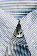 close up of a striped shirts collar