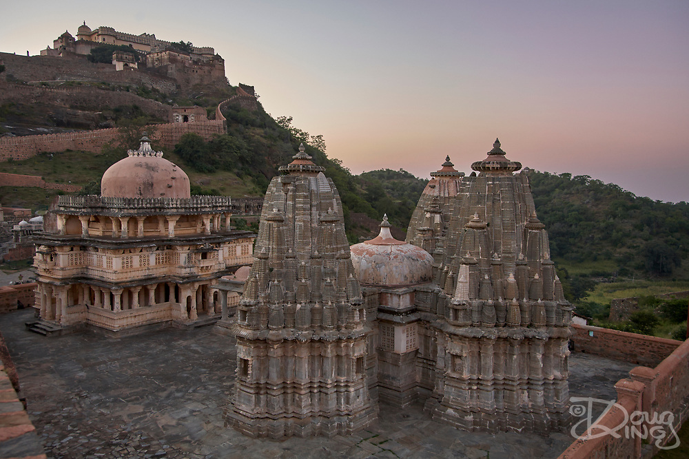 The Parsvanath Jain Temple in the foreground with the ramparts of the Kumbha Palace behind within the World Heritage Kumbhalgarh Mewar Hill Fort Rajasthan India.