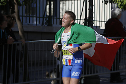 November 13, 2016 - Athens, Attica, Greece - A runner is wrapped in an Italian flag. Thousands of people from all over the world took part in the 2016 Athens Marathon the Authentic, which starts in the town of Marathon and is ending in Athens, the route, which according to legend was first run by the Greek messenger Pheidippides in 490 BC. (Credit Image: © Michael Debets/Pacific Press via ZUMA Wire)