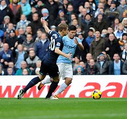 Manchester City's Sergio Aguero is fouled by Tottenham Hotspur's Michael Dawson - Photo mandatory by-line: Dougie Allward/JMP - Tel: Mobile: 07966 386802 24/11/2013 - SPORT - Football - Manchester - Etihad Stadium - Manchester City v Tottenham Hotspur - Barclays Premier League
