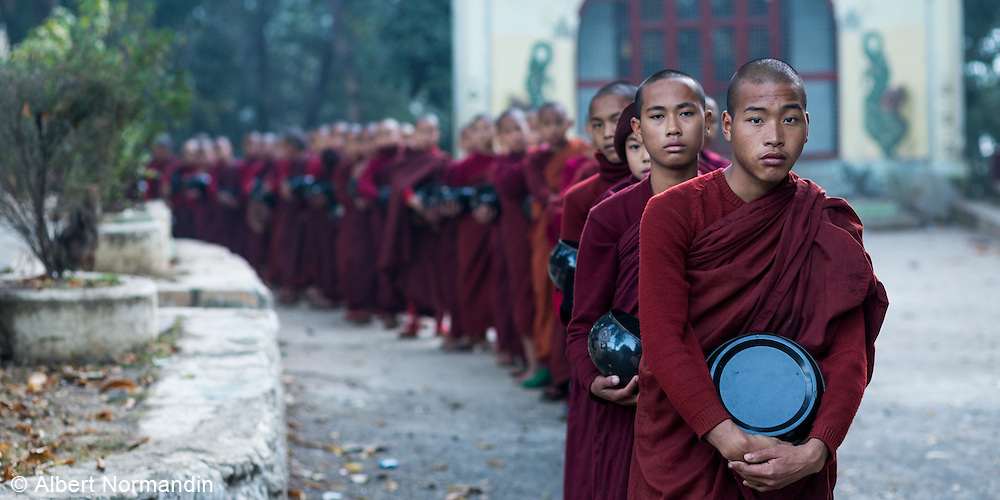 Long line of Monks heading out for collection of alms,, Zwé Taw Monastery and Education School