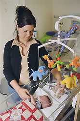 Mother on Neonatal unit feeding premature oxygen dependent baby; which was born at 28 weeks and is now 17 weeks old; using tube,