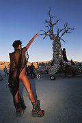 """One of many mobile art installations at Burning Man that became a gathering point in the late afternoon. The """"Spirit of Time"""" or the """"Tree of Time"""" was constructed by artist Dana Albany out of animal bones and had a constant droning sound component. Burning Man is a performance art festival known for art, drugs and sex. It takes place annually in the Black Rock Desert near Gerlach, Nevada, USA."""