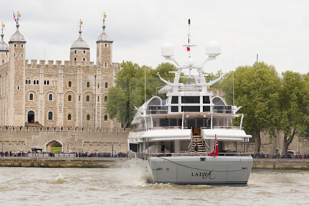 © Licensed to London News Pictures. 13/05/2018. London, UK. Alan Sugar sails his luxury superyacht, Lady A on the River Thames in front of the Tower of London this afternoon after it passed under Tower Bridge and parades in the Upper Pool in central London, before passing under Tower Bridge again and travelling east along the river. Alan Sugar reportedly purchased the 181 feet long yacht in 2015 and renamed her Lady A after his wife, Ann and it includes a jacuzzi and can sleep up to 12 guests. Lady A is reportedly still up for sale at around £13m after being put on the market last year, or it can be chartered with prices starting from around £12,500 per week. . Photo credit: Vickie Flores/LNP