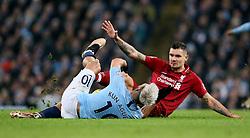 Liverpool's Dejan Lovren (right) fouls Manchester City's Sergio Aguero (left) during the Premier League match at the Etihad Stadium, Manchester.