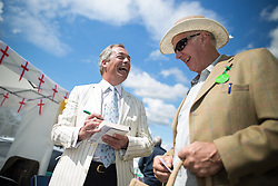 © Licensed to London News Pictures. 31/07/2015. Leeds , UK . NIGEL FARAGE signs copies of his book at the CLA GameFair ( Country Landowners Association ) at Harewood House in Yorkshire . Photo credit: Joel Goodman/LNP
