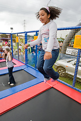 Young girl having fun on a trampoline at a Parklife summer activities event,