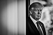President Donald Trump looks over at the media as he waits to  greet Klaus Iohannis, Romania's president, at the West Wing of the White House in Washington, District of Columbia, U.S., on Friday, June 9, 2017. Trump and Iohannis will discuss the 20-year-old strategic partnerships that the two countries have.