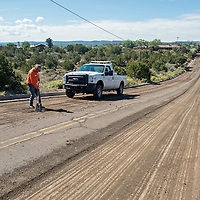 010311       Brian Leddy<br /> City of Gallup worker Rusty Swatzell works on Grandview Drive Wednesday morning. In addition to fixing the scarred asphalt, the city is also replacing a waterline between Phillipin and Logan.
