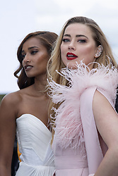 Nidhi Sunil and Amber Heard posing on the runway after the L'Oreal show as part of Paris Fashion Week Womenswear Spring/Summer 2022 in Paris, France on October 03, 2021. Photo by Aurore Marechal/ABACAPRESS.COM